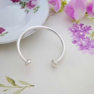 Rebecca sterling silver torque bangle