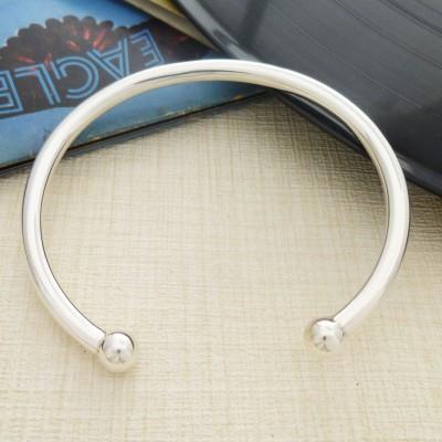 Men's solid silver torque bangle
