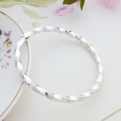 Imogen large size twisted silver bangle