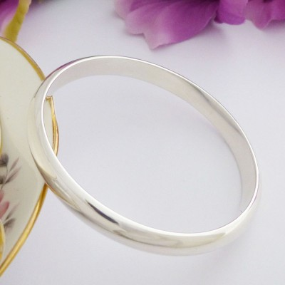 Arianna solid weighty silver bangle
