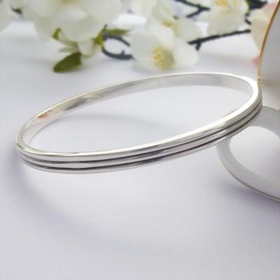 Phoebe silver bangle engraved inside
