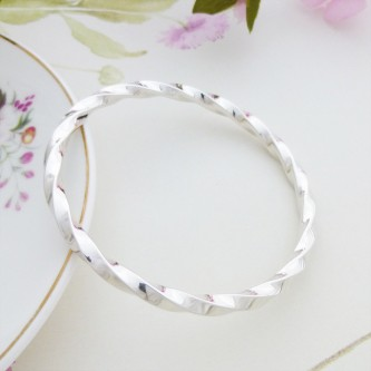 Imogen large size twisted silver bangle