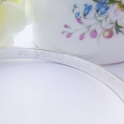 Sterling silver bangle with 25 year anniversary engraved