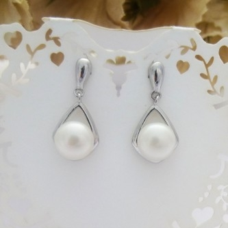 bridal freshwater pearl earrings with a sterling silver swirl