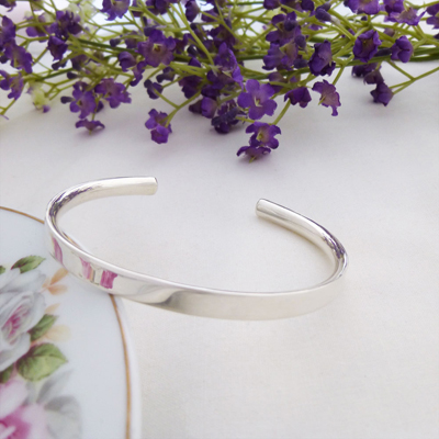 Alexa sterling silver ladies torque bangle